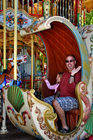 Sara and dad on the merry go round